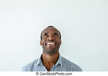 Overjoyed afro american man looking up