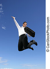 Overjoyed businessman jumping in the air