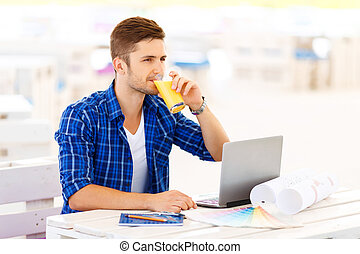 Overjoyed freelancer sitting at the table