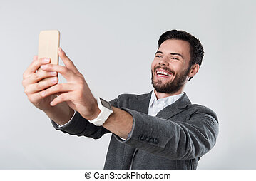 Overjoyed handsome man using smartphone. - Let me take a...