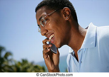 Overjoyed man talking on his mobile phone