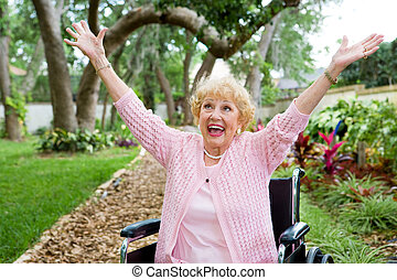 OVERJOYED - Senior lady in wheelchair is ecstatic as she...