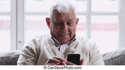 Overjoyed senior old 80s man hold phone look at screen excited about mobile app sport bet bid win concept, happy elder grandfather winner celebrate victory success read good news in cell text message