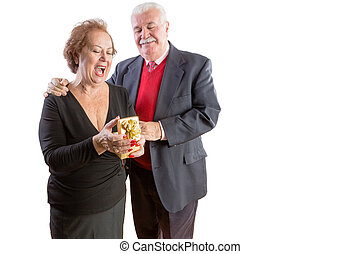 Overjoyed senior woman receiving a Valentines gift