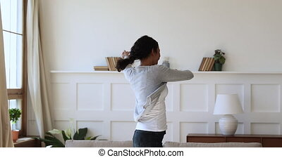 Excited homeowner spinning with stretched arms, real estate ...