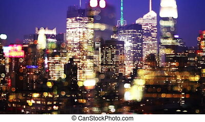 overlayed abstract timelapse of midtown manhattan skyline from a high vantage point at night