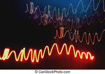 Overlaying wavy lines forming an abstract pattern on a dark background.