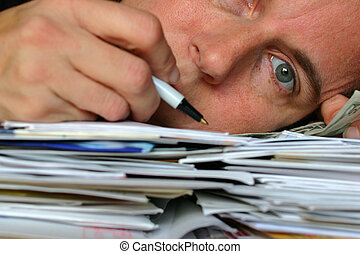 Overload - closeup of a person laying on a pile of letters...