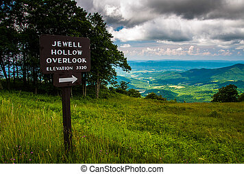 Overlook sign and view on Skyline Drive in Shenandoah...