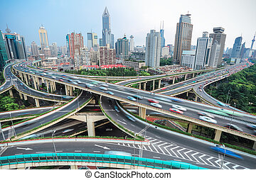 overlooking the vehicle motion blur on shanghai elevated road junction and interchange overpass