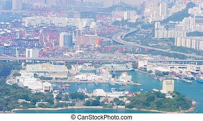 Hong Kong's distinctive cityscape with a complex, elevated highway system and commercial shipping container yards. Video 4k