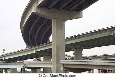 Overpass #1 - Looking like cement spaghetti, cars are routed...