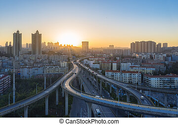 overpass in sunrise on kunming - aerial view of overpass in ...