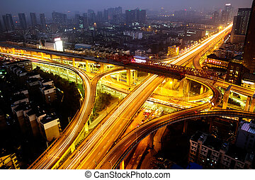 Overpass in the night with cars light in modern city