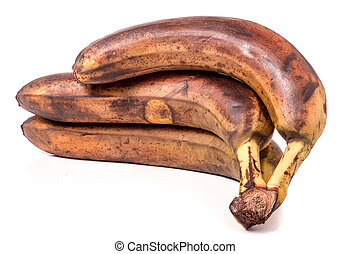 Overripe bananas in front of a white background.