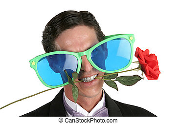 Oversize Glasses & Rose - A handsome man in a tuxedo with a...