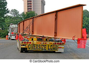 A giant steel beam for a highway bridge on a truck