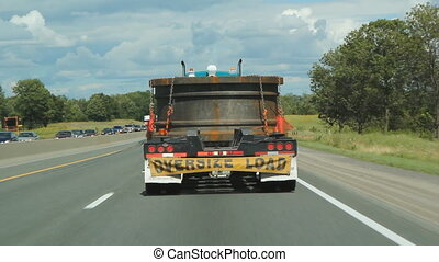 Oversize load. - Truck with oversized load going down the...