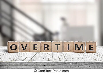 Overtime word spelled with wooden blocks