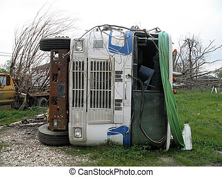 Overturned - cab of 18 wheeler lays on its side after being ...