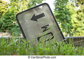 Overturned distance sign. - Overturned distance sign in the ...