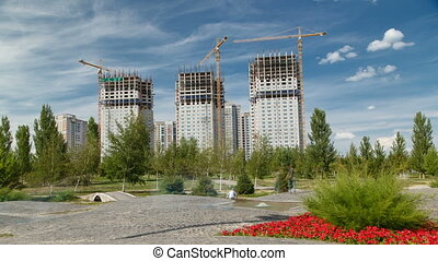 Overview of a large construction site timelapse near new mosque and the Palace of Peace and Reconciliation in Astana