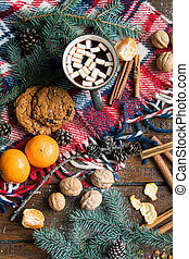 Christmas symbols, traditional food and spices other objects on wooden table
