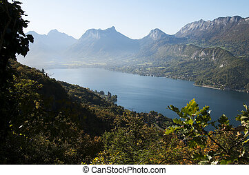 Overview of the south part of lake Annecy and mountains, at autumn on morning. France