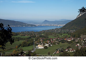 Overview of lake Annecy, city and villages at autumn, in...