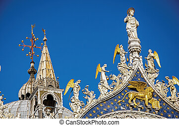 Overview of sculptures and frontispiece made in marble and gold on the San Marco Basilica. At the city of Venice.