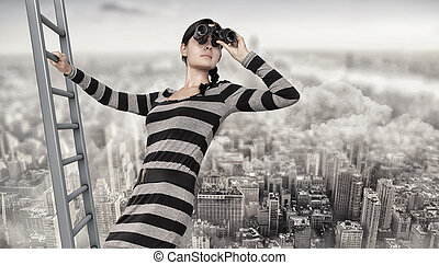woman stands on top of a ladder using a spyglass