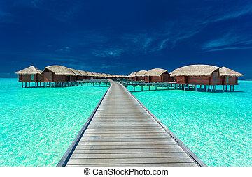 overwater, landhäuser, auf, der, tropische , lagune, malediven