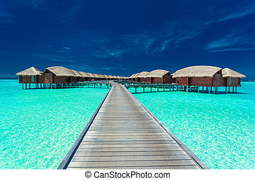 Overwater villas on the tropical lagoon, Maldives