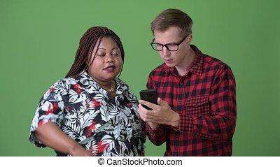 Overweight African woman and young Scandinavian man together...