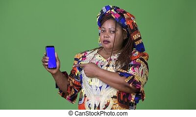 Overweight beautiful African woman wearing traditional...