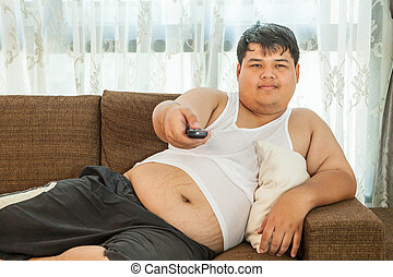 Overweight guy to watch some TV
