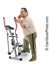 Overweight man eating by an exercising device - Overweight...