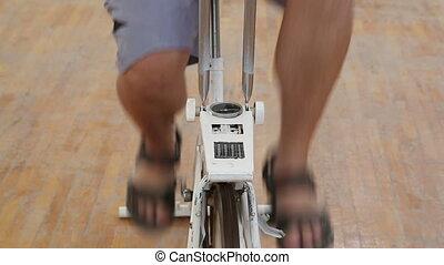 overweight man exercising legs