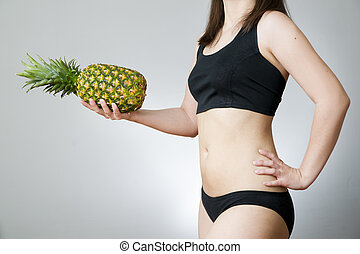 Overweight of the women with pineapple