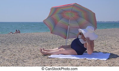 Overweight person at the summer beach vacation