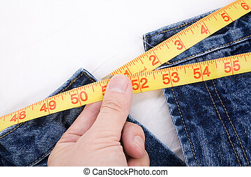 Overweight - a blue jean and ruler, concept of Overweight