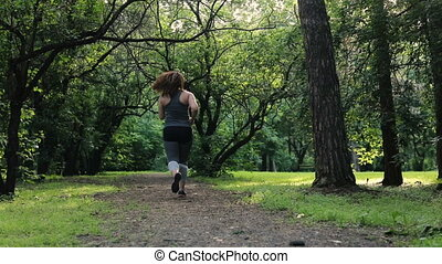 Overweight woman back running. Weight loss concept