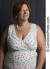 overweight woman in a summer dress