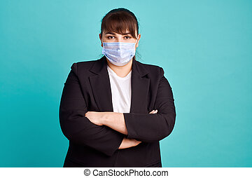 Overweight woman in suit and medical mask
