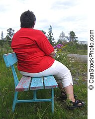 Overweight woman - Lonely overweight woman sitting on a ...