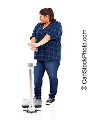 overweight woman refuse to go on scale