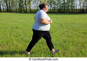 overweight woman running on meadow - sport - overweight ...