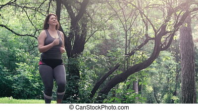 Overweight woman running. Weight loss concept.