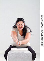 overweight woman smash scale