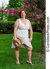 overweight woman with a straw hat
